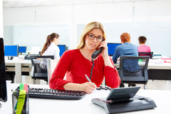 Blond businesswoman in call center working office Stock Photos