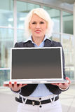 Blond businesswoman  with computer Royalty Free Stock Images