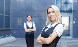 A blond businesswoman in front of her colleague Royalty Free Stock Photo