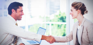 Blond businesswoman having an interview. In office and shaking hands with interviewer Royalty Free Stock Image