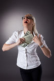 Blond businesswoman hide money under shirt Royalty Free Stock Photography