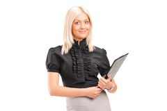 Blond businesswoman holding a clipboard Stock Photo