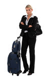 Blond businesswoman with luggage Royalty Free Stock Image