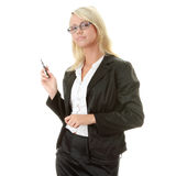 Blond businesswoman with pen Royalty Free Stock Photos