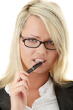 Blond businesswoman with pen Stock Images