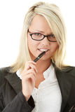 Blond businesswoman with pen. Isoalted on white background Royalty Free Stock Image