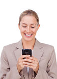 A blond businesswoman with a phone Royalty Free Stock Photography