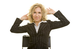 Blond businesswoman relaxing. Half body portrait of attractive blond businesswoman sat on chair stretching, white background stock image