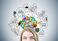 Blond businesswoman s head, brain with gears Royalty Free Stock Photo