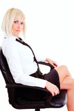 Blond businesswoman sitting on chair Stock Photos