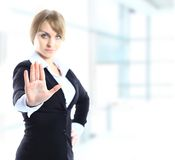 Blond businesswoman with stop hand sign gesture Royalty Free Stock Images