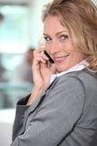 Blond businesswoman taking a call Stock Images