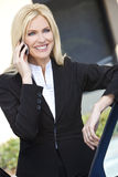 Blond Businesswoman Talking On Her Cell Phone Royalty Free Stock Photography