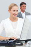 Blond businesswoman working at her computer Royalty Free Stock Images