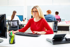 Blond businesswoman working office with computer Stock Image