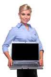 Blond busineswoman holding a laptop with copy spac stock photos