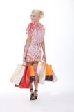 Blond carrying shopping bags Stock Image