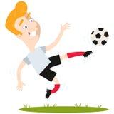 Blond caucasian cartoon football striker kicking football in mid-air Royalty Free Stock Image