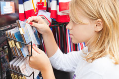 Blond Caucasian girl considers souvenirs Royalty Free Stock Photography