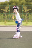 Blond caucasian girl skating on a track Stock Photography