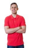 Blond caucasian grabb med den röda skjortan och korsade armar royaltyfri bild