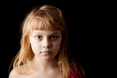Blond Caucasian little girl on black Stock Photo