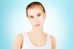 Blond caucasian model portrait with surgery lines on face, blue Stock Photo