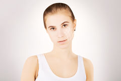 Blond caucasian model portrait with surgery lines on face, grey Royalty Free Stock Photo