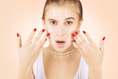 Blond caucasian model portrait with surgery lines on face, pink Royalty Free Stock Photos