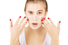 Blond caucasian model portrait with surgery lines on face, white Royalty Free Stock Images
