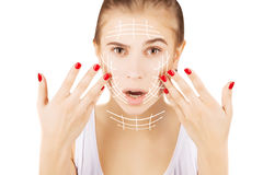 Blond caucasian model portrait with surgery lines on face, white stock photo