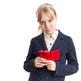 Blond Caucasian schoolgirl with mobile phone Royalty Free Stock Photos