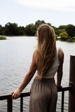 Blond Caucasian Teen Girl Standing At Rail Looking At River Royalty Free Stock Image