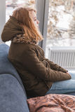Blond Caucasian teenage girl in warm clothes Royalty Free Stock Image