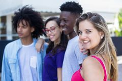 Blond caucasian woman with african and latin american young adults. Blond caucasian women with african and latin american young adults outdoor in the city stock photography