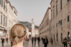 Blond caucasian woman in Dubrovnik stock photos