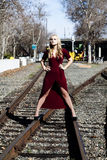 Blond Caucasian Woman Standing On Railroad Tracks In Dress Royalty Free Stock Photos