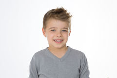 Blond cheerful kid on isolated background Stock Image