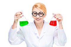 Blond chemist holds a test tube with a colored liquid on a white Royalty Free Stock Photo