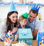 Blond child celebrating his birthday. In the kitchen Stock Photo