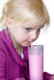 Blond child drinking milkshake royalty free stock photo