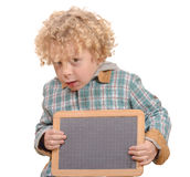 Blond child with empty slate to put words on a Royalty Free Stock Image