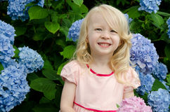 Blond child with flowers Stock Photo