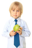 Blond child holding fruit. Series Stock Image