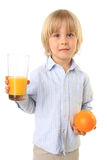 Blond child holding orange and glass of juice Stock Photography
