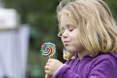 Blond child licking a lollipop Royalty Free Stock Photo
