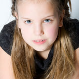 Blond child making eye contact Stock Image