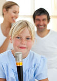 Blond child singing with a microphone Royalty Free Stock Photo