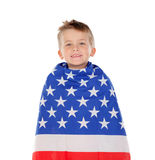Blond child wrapped on American flag Stock Image