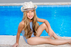 Blond children girl sittin in swimming pool border Stock Photos